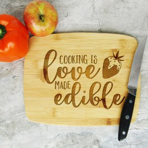 Cooking is Love Made Edible Cutting Board