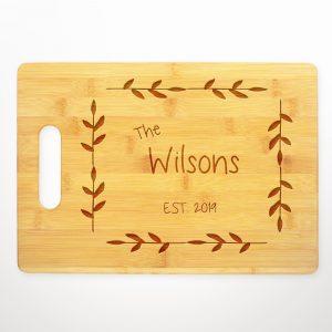 last-name-established-leaf-border-cutting-board